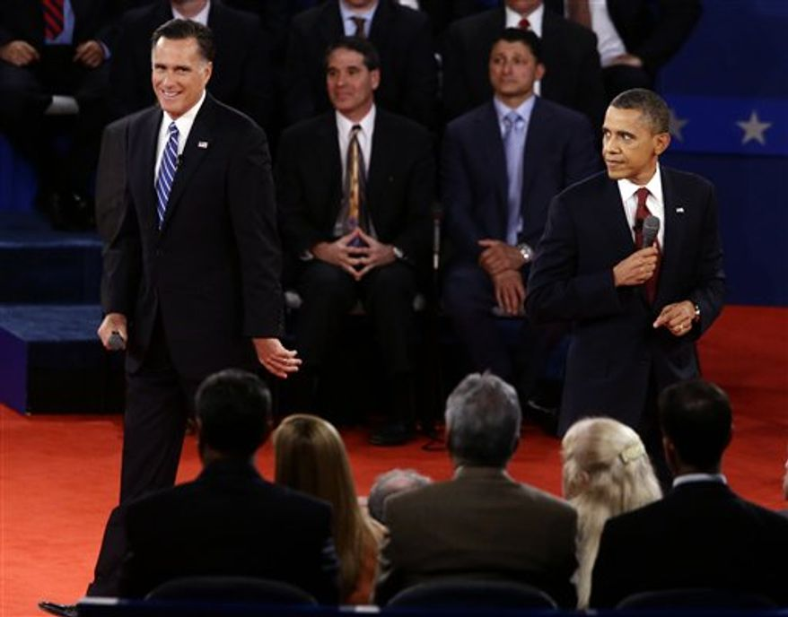 President Barack Obama and Republican presidential candidate and former Massachusetts Gov. Mitt Romney participate in the second presidential debate at Hofstra University in Hempstead, N.Y., Tuesday, Oct. 16, 2012. (AP Photo/Charles Dharapak)