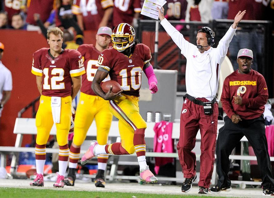 Washington Redskins quarterback Robert Griffin III (10) runs 76 yards for a touchdown to put the Washington Redskins up 38-26 in the fourth quarter as the Washington Redskins play the Minnesota Vikings at FedEx Field, Landover, Md., Sunday, October 14, 2012. (Craig Bisacre/ The Washington Times)