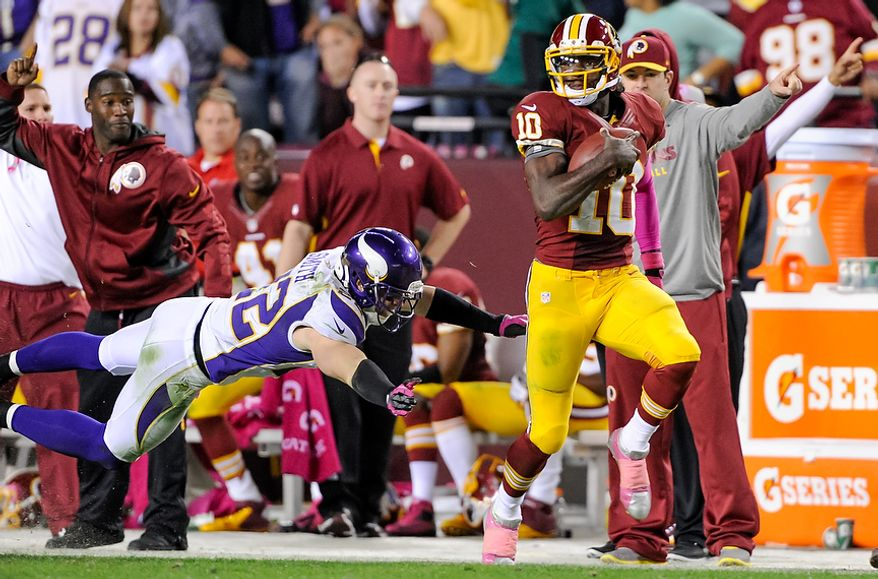 Washington Redskins quarterback Robert Griffin III (10) runs 76 yards for a touchdown to put the Washington Redskins up 38-26 in the fourth quarter as the Washington Redskins play the Minnesota Vikings at FedEx Field, Landover, Md., Sunday, October 14, 2012. (Preston Keres, Special to the Washington Times)