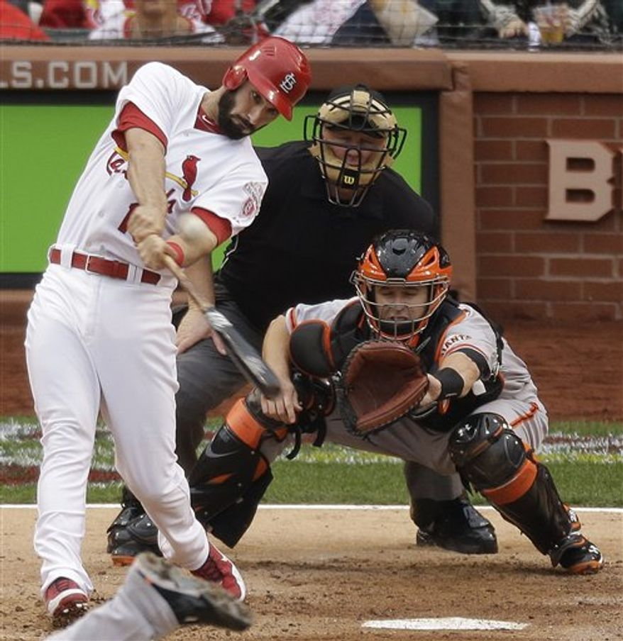 St. Louis Cardinals' Matt Carpenter (13) hits a two-run home run during the third inning of Game 3 of the National League Championship Series against the San Francisco Giants, Wednesday, Oct. 17, 2012, in St. Louis. The Cardinals won 3-1 to take a 2-1 lead in the series. (AP Photo/Mark Humphrey)