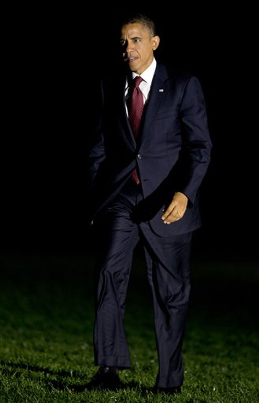 President Barack Obama arrives the White House in Washington early Wednesday, Oct. 17, 2012, following the second presidential debate with Republican presidential candidate Mitt Romney, at Hofstra University in Hempstead, N.Y. (AP Photo/Manuel Balce Ceneta)