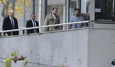Mark Francis Brzezinski (second from right), U.S. ambassador to Sweden, re-enters the U.S. Embassy in Stockholm after getting the all-clear by police investigating a suspicious letter on Wednesday, Oct. 17, 2012. (AP Photo/Scanpix Sweden, Claudio Bresciani)