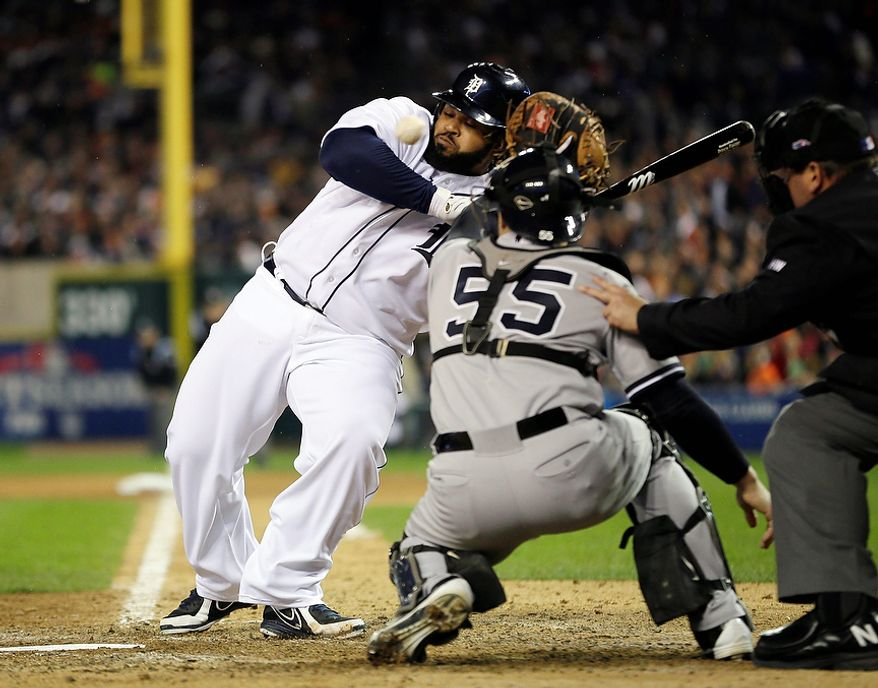 Detroit Tigers' Prince Fielder dodges an inside pitch from New York Yankees' Boone Logan in the seventh inning during Game 3 of the American League championship series Tuesday, Oct. 16, 2012, in Detroit. (AP Photo/Matt Slocum)