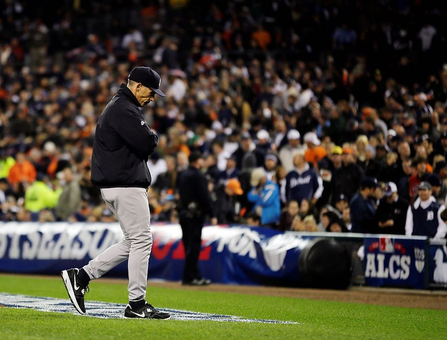 New York Yankees manger Joe Girardi walks back to the dugout after removing starting pitcher Phil Hughes due to injury in the fourth inning during Game 3 of the American League championship series against the Detroit Tigers Tuesday, Oct. 16, 2012, in Detroit. (AP Photo/Matt Slocum)