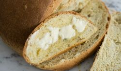 Seed-studded egg bread nicely accompanies a warm fall meal. (Associated Press)