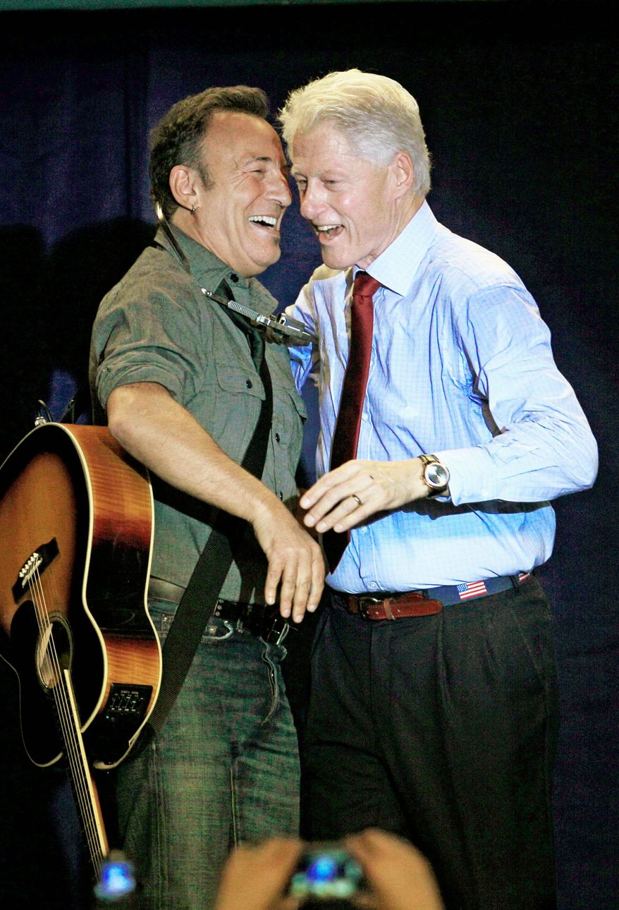Former President Bill Clinton laughs with singer Bruce Springsteen during a campaign event for President Obama in Parma, Ohio, on Thursday. (Associated Press)