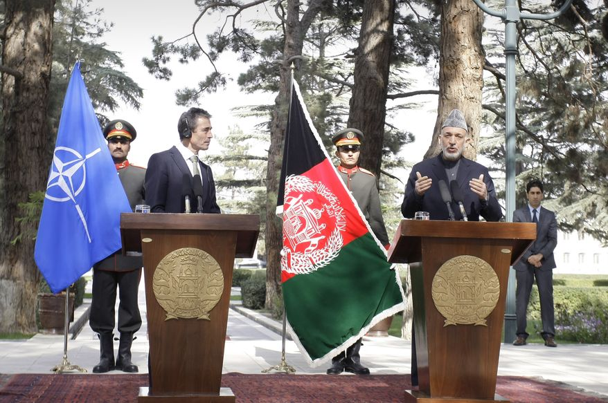 Afghan President Hamid Karzai (right) speaks during a joint press conference with NATO Secretary-General Anders Fogh Rasmussen at the presidential palace in Kabul, Afghanistan, on Thursday, Oct. 18, 2012. (AP Photo/Musadeq Sadeq)