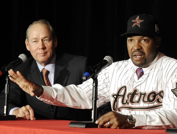 Houston Astros' new manager Bo Porter, right, with owner Jim Crane, answers questions during a news conference, Thursday, Oct. 18, 2012, in Houston. (AP Photo/Pat Sullivan)