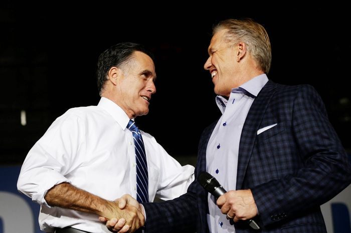 Former NFL quarterback John Elway arrives to campaign for Republican presidential candidate and former Massachusetts Gov. Mitt Romney at Wings Over the Rockies Air and Space Museum in Denver, Monday, Oct. 1, 2012. (AP Photo/Charles Dharapak)
