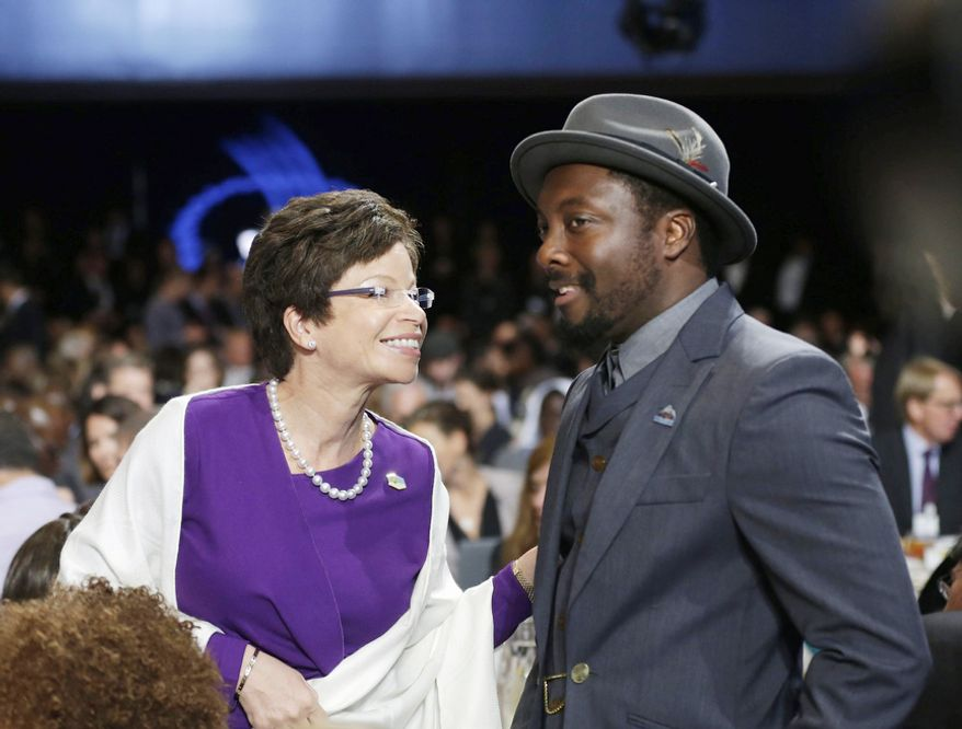 White Senior Adviser Valerie Jarrett, left, talks with singer William Adams, also know professionally as Will.i.am, Tuesday, Sept. 25, 2012, at the Clinton Global Initiative Annual meeting in New York. (AP Photo/Pablo Martinez Monsivais)