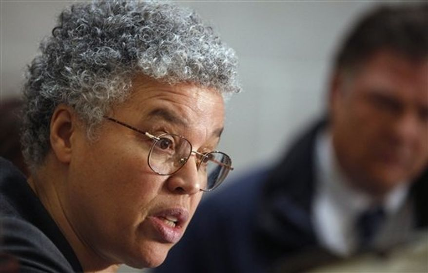 ** FILE ** In this Jan. 26, 2012, file photo, Cook County Board President Toni Preckwinkle speaks at a news conference in Chicago. (AP Photo/M. Spencer Green, File)