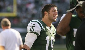 New York Jets quarterback Tim Tebow stands on the the sidelines in the second half of an NFL football game against the Indianapolis Colts, Sunday, Oct. 14, 2012, in East Rutherford, N.J. (AP Photo/The Record of Bergen County, Chris Pedota) ONLINE OUT; MAGS OUT; TV OUT; INTERNET OUT;  NO ARCHIVING; MANDATORY CREDIT