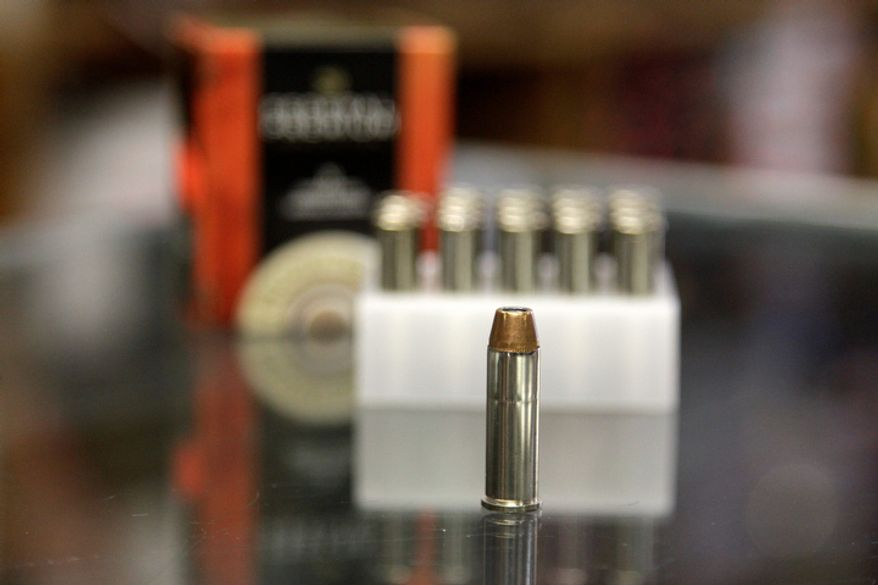 In this Wednesday, Oct. 17, 2012 photo, a box of ammunition is seen on the counter of a gun shop in Tinley Park, Ill. Cook County Board President Toni Preckwinkle is set to make official her latest tax target: bullets. On Thursday Oct. 18, she will propose a tax of five cents a bullet. and a dollar for a box of 20. (AP Photo/M. Spencer Green)