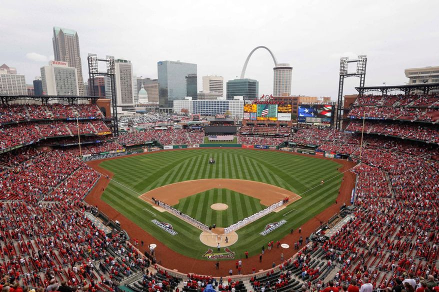 Players line up at the Busch Stadium before the start of Game 3 of baseball's National League championship series between the St. Louis Cardinals and the San Francisco Giants, Wednesday, Oct. 17, 2012, in St. Louis. (AP Photo/Patrick Semansky)