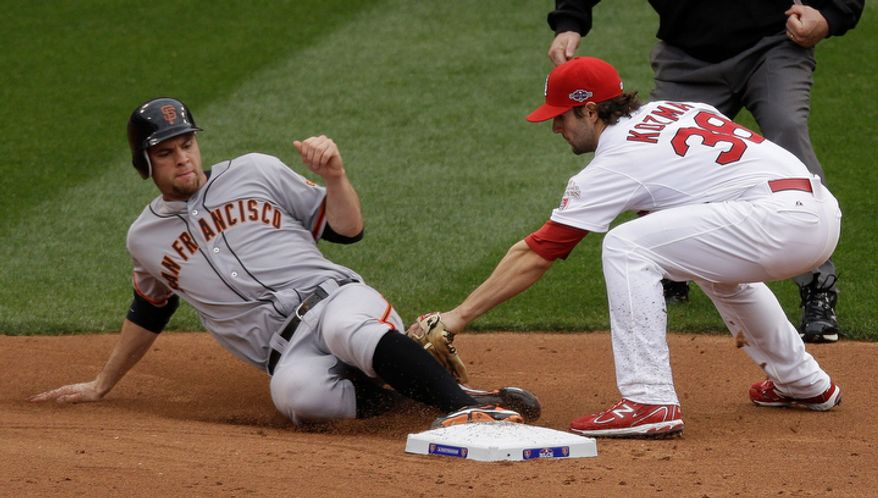 San Francisco Giants first baseman Brandon Belt (9) slides safe to second base on a fielder's choice against St. Louis Cardinals shortstop Pete Kozma (38) during the second inning of Game 3 of baseball's National League championship series , Wednesday, Oct. 17, 2012, in St. Louis. (AP Photo/Mark Humphrey)