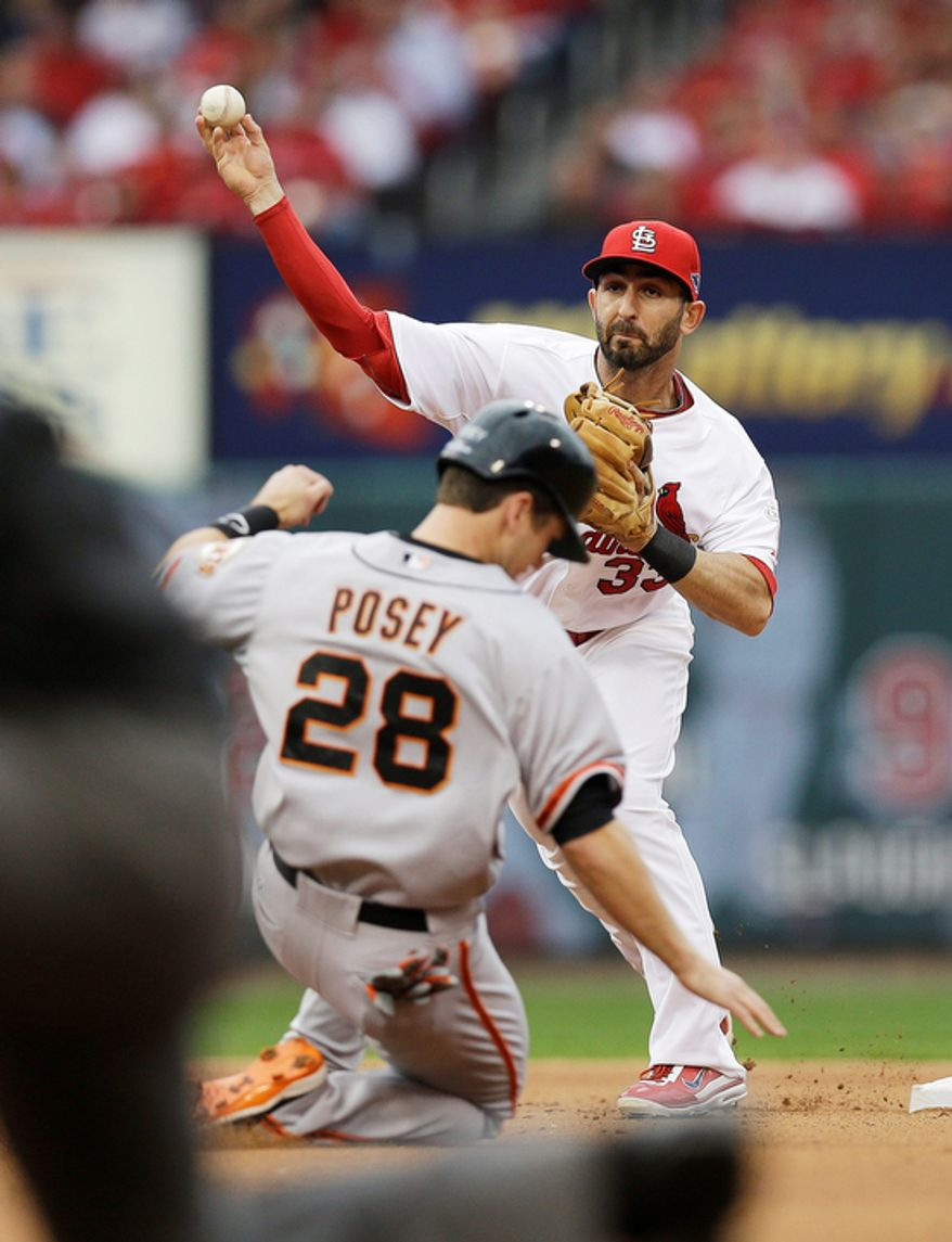 St. Louis Cardinals second baseman Daniel Descalso (33) throws to first for a double play taking San Francisco Giants' Buster Posey (28) out at second base as Hunter Pence (8) is out at first during the third inning of Game 3 of baseball's National League championship series, Wednesday, Oct. 17, 2012, in St. Louis. (AP Photo/David J. Phillip)