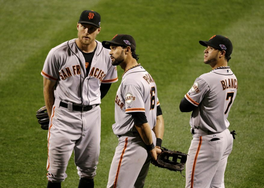 San Francisco Giants outfielders Hunter Pence (8), Angel Pagan (16) and Gregor Blanco (7) look at the scoreboard as they talk during the pitching change during the eighth inning of Game 3 of baseball's National League championship series against the St. Louis Cardinals, Wednesday, Oct. 17, 2012, in St. Louis. (AP Photo/Mark Humphrey) 5