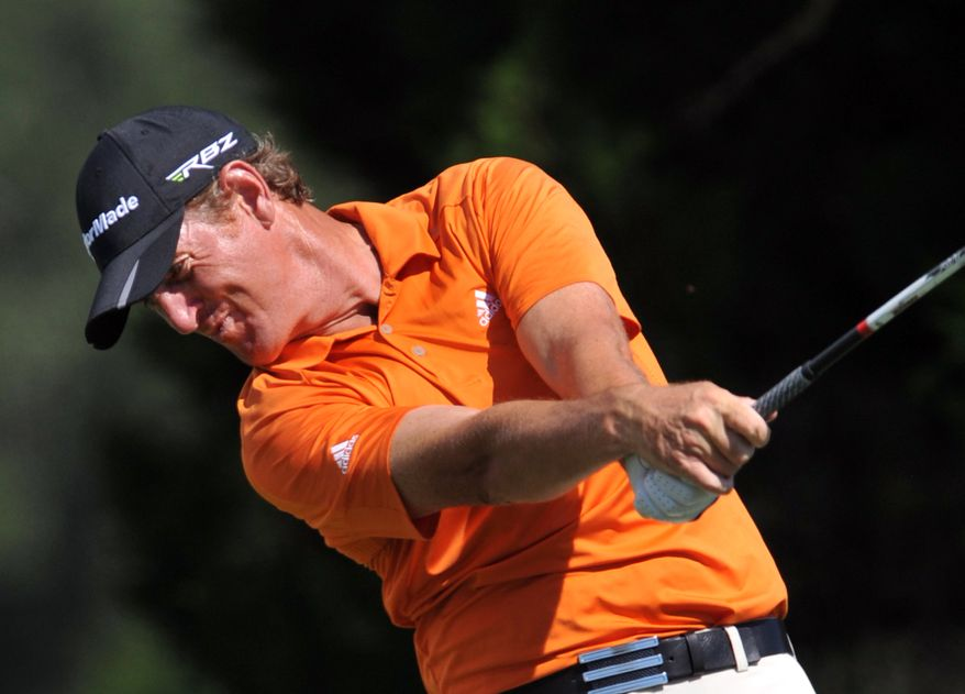 Greg Owens, of England, hits his drive off the ninth tee during the first round of The McGladrey Classic PGA Tour golf tournament Thursday, Oct. 18, 2012 in St. Simons Island, Ga. (AP Photo/Stephen Morton)