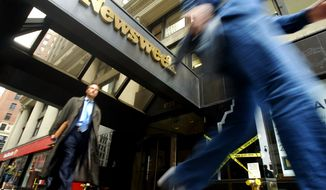 Pedestrians pass the Broadway entrance to the Newsweek building in New York in 2005. (AP Photo/Mary Altaffer)