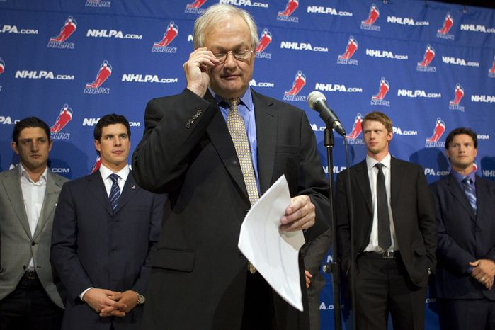 """NHL Players' Association executive director Donald Fehr (center) glances at his notes as he stands in front of players, including Pittsburgh Penguins' Sidney Crosby (second from left), following collective bargaining talks in Toronto on Oct. 18, 2012. NHL Commissioner Gary Bettman received three counter-proposals from the players' association on Thursday and left the negotiating table """"thoroughly disappointed,"""" further shrinking the possibility of a full hockey regular season. (Associated Press/The Canadian Press)"""