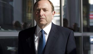NHL Commissioner Gary Bettman arrives for negotiations with the NHL Players' Association in Toronto Thursday, Oct. 18, 2012. The NHL Players' Association confirmed it will make a new offer during negotiations on Thursday. On Tuesday, the NHL proposed a 50-50 hockey-related revenue split and an 82-game regular season.  (AP Photo/The Canadian Press, Chris Young)