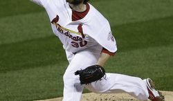 St. Louis Cardinals relief pitcher Jason Motte (30) works during the eighth inning of Game 3 of baseball's National League championship series against the San Francisco Giants, Wednesday, Oct. 17, 2012, in St. Louis. (AP Photo/Patrick Semansky)