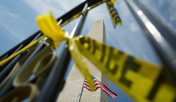 As the one-year anniversary of the August 23, 2011 5.8 earthquake approaches, the Washington Monument a barricade with police tape keeps visitors from getting too close, and stands empty of tourists in Washington, D.C., Wednesday, August 22, 2012. (Rod Lamkey Jr./The Washington Times)