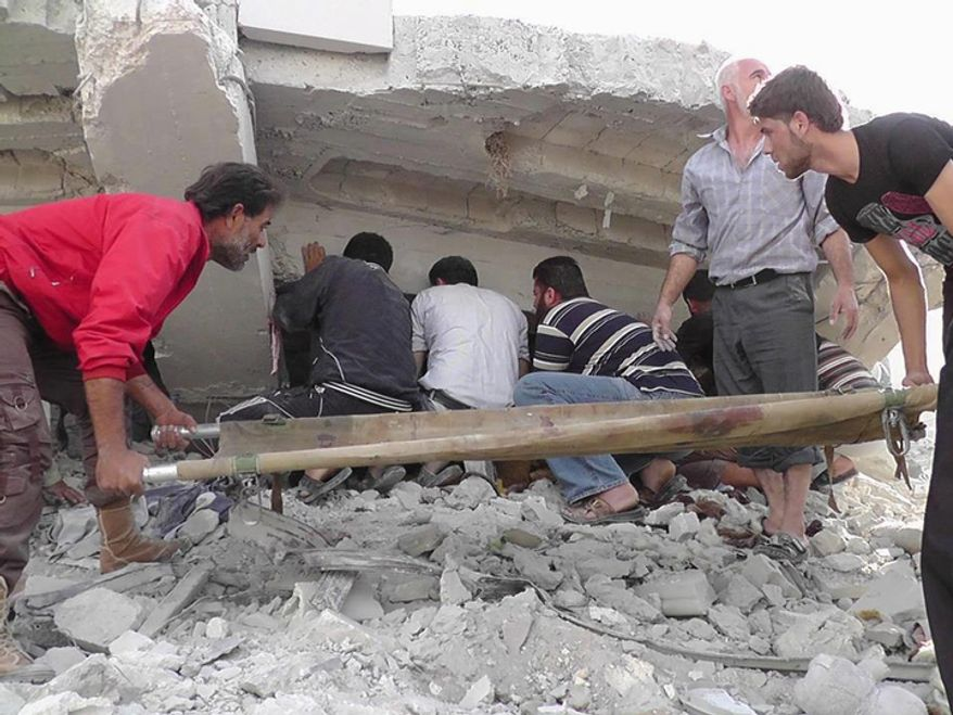 In this Wednesday, Oct. 17, 2012 photo. citizen journalism image provided by Edlib News Network, ENN, which has been authenticated based on its contents and other AP reporting, Syrian citizens search under rubble to rescue people from a building that was destroyed from a Syrian forces airstrike, at Kfar Nebel town, in Idlib province, northern Syria. (AP Photo/Idlib News Network ENN)