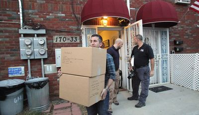 Law enforcement officials remove boxes of potential evidence from the New York home where Quazi Mohammad Rezwanul Ahsan Nafis was staying, Wednesday, Oct. 17, 2012. Nafis was arrested in an FBI sting operation earlier in the day after attempting to blow up a fake car bomb outside the Federal Reserve building in Manhattan, authorities said. (AP Photo/Newsday, Howard Schnapp) NYC OUT; NO SALES