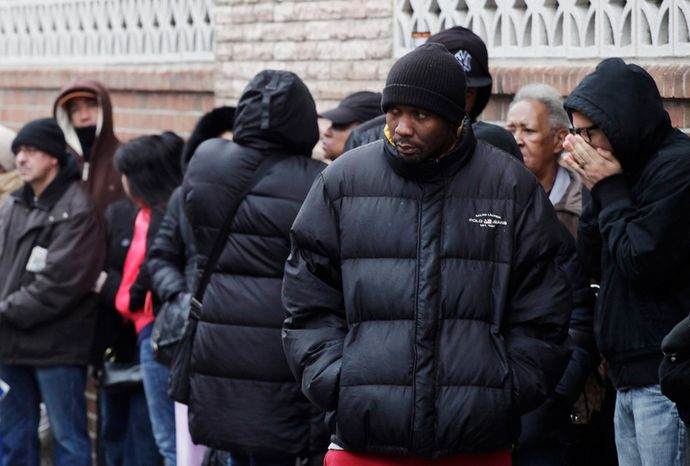 **FILE** People wait in line to enter the Northern Brooklyn Food Stamp and DeKalb Job Center in New York on Feb. 24, 2012. (Associated Press)