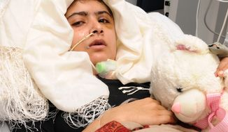 Pakistani shooting victim Malala Yousufzai, 15, recovers in Queen Elizabeth Hospital in Birmingham, England, after being attacked and shot in the head Oct. 9, 2012, by Taliban gunmen in Pakistan for advocating education for girls. (Associated Press/University Hospitals Birmingham NHS Foundation Trust)