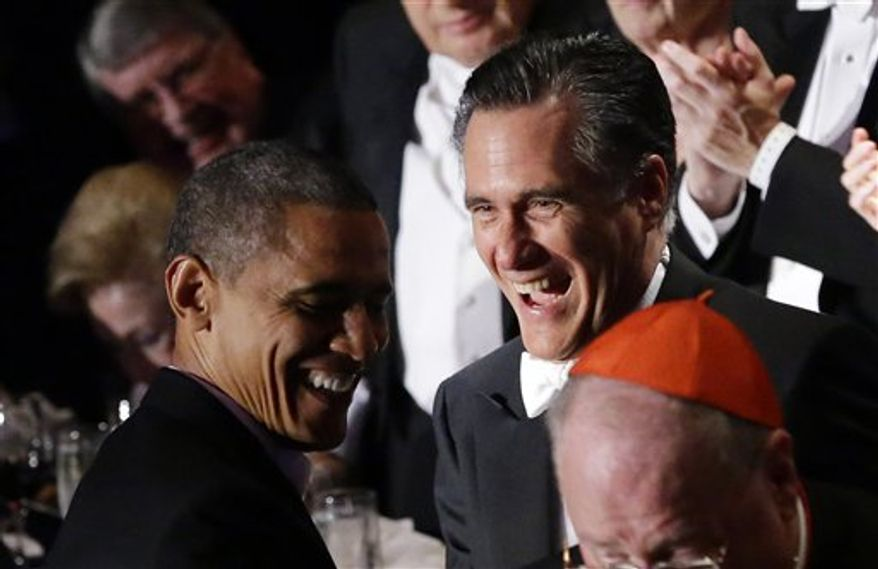 Republican presidential candidate Mitt Romney and President Obama laugh Oct. 18, 2012, as Romney gets up to address the 67th annual Alfred E. Smith Memorial Foundation Dinner, a charity gala organized by the Archdiocese of New York at the Waldorf Astoria hotel in New York. (Associated Press)