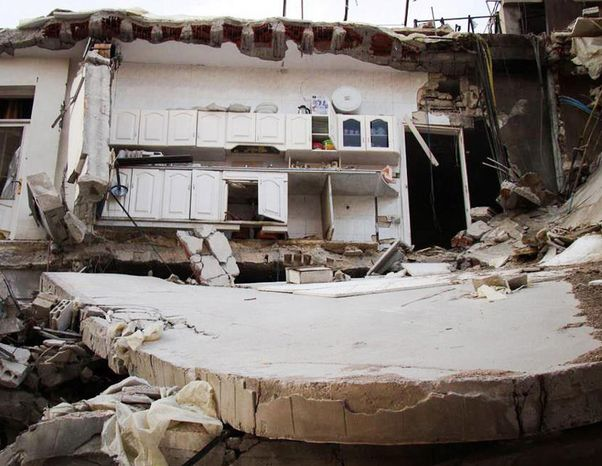 In this citizen journalism image provided by Lens Young Homsi, which has been authenticated based on its contents and other AP reporting, a destroyed house from Syrian government forces shelling is seen Oct. 18, 2012, at Jouret al-Shiyah, in the Homs province of Syria. (Associated Press)