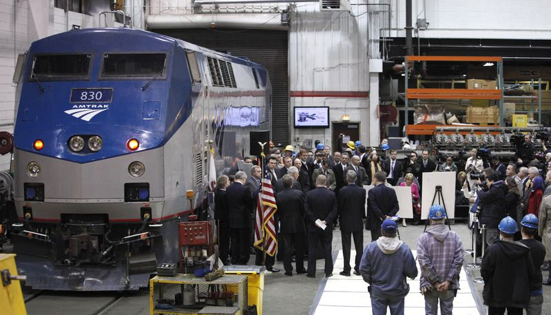 **FILE** Illinois Gov. Pat Quinn and U.S. Sen. Dick Durbin are joined by state and local officials March 22, 2011, as they announce the next phase of high-speed rail construction during a news conference at an Amtrak maintenance building in Chicago. (Associated Press)
