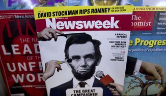**FILE** A copy of Newsweek is seen Oct. 18, 2012, at Joe's Smoke Shop in Portland, Maine. (Associated Press)