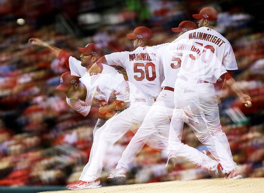 St. Louis Cardinals starting pitcher Adam Wainwright pitches in a multiple-exposure sequence in the fifth inning of Game 4 of the National League Championship Series between the Cardinals and the San Francisco Giants on Oct. 18, 2012, in St. Louis. (Associated Press/St. Louis Post-Dispatch)