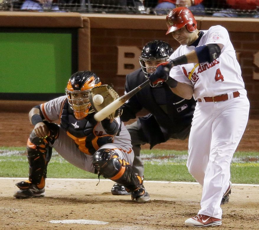 St. Louis Cardinals' Yadier Molina hits a run-scoring double during the seventh inning of Game 4 of the National League Championship Series against the San Francisco Giants on Oct. 18, 2012, in St. Louis. (Associated Press)