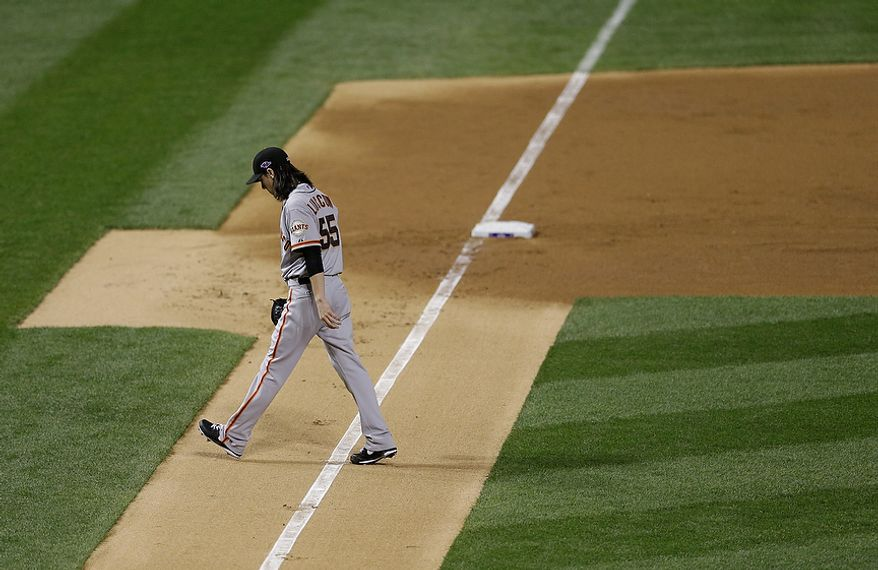 San Francisco Giants starting pitcher Tim Lincecum walks off the field after the first inning of Game 4 of the National League Championship Series against the St. Louis Cardinals on Oct. 18, 2012, in St. Louis. (Associated Press)