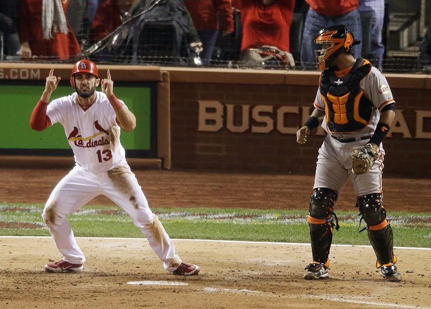 St. Louis Cardinals' Matt Carpenter reacts in front of San Francisco Giants catcher Hector Sanchez after scoring from second on a single by Matt Holliday during the fifth inning of Game 4 of baseball's National League championship series Thursday, Oct. 18, 2012, in St. Louis. (AP Photo/Mark Humphrey)