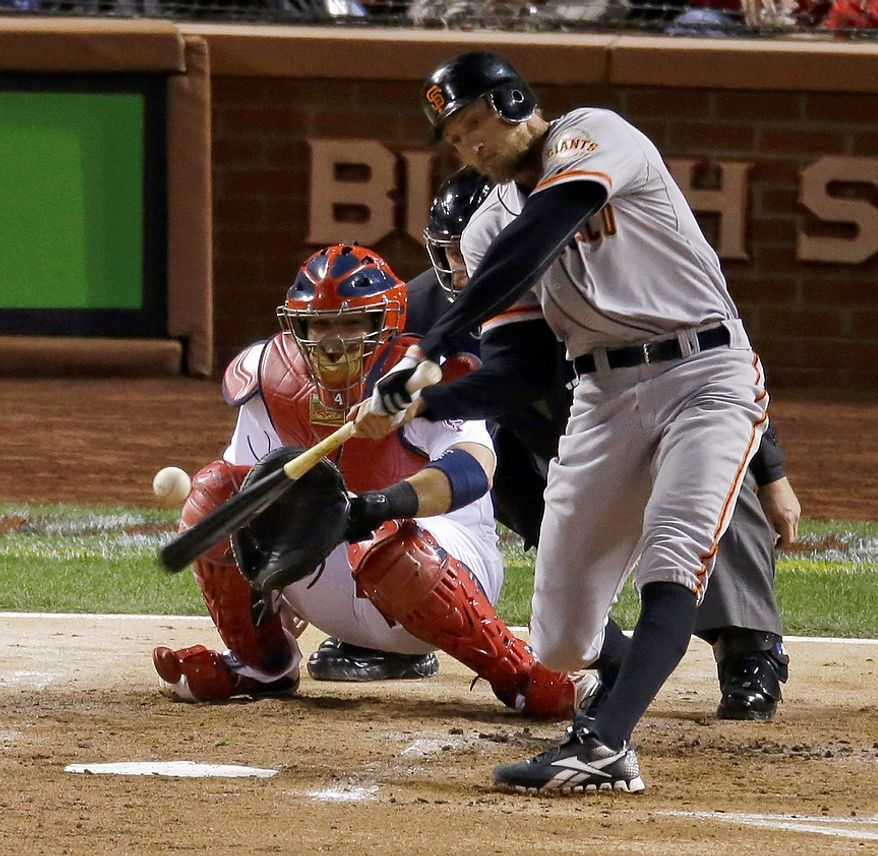 San Francisco Giants OF Hunter Pence hits a home run during the second inning of Game 4 of the National League Championship Series against the St. Louis Cardinals on Oct. 18, 2012, in St. Louis. (Associated Press)