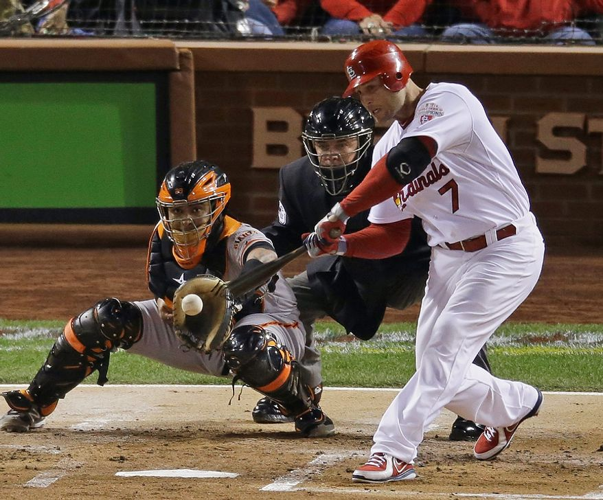 St. Louis Cardinals 1B Matt Holliday hits an RBI single during the first inning of Game 4 of the National League Championship Series against the San Francisco Giants on Oct. 18, 2012, in St. Louis. (Associated Press)