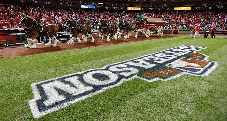 The Budweiser Clydesdales walk around Busch Stadium in St. Louis before Game 4 of the National League Championship Series between the San Francisco Giants and the St. Louis Cardinals on Oct. 18, 2012. (Associated Press)