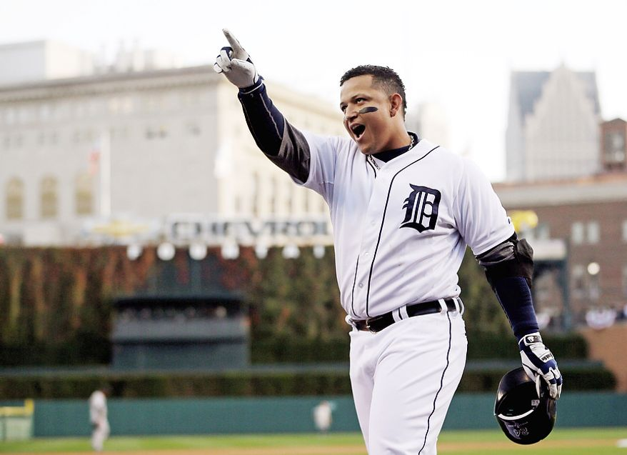 Detroit Tigers' Miguel Cabrera celebrates after hitting a two-run home run against the New York Yankees in the fourth inning of Game 4 of the American League Championship Series on Oct. 18, 2012, in Detroit. The Tigers won, 8-1, to move on to the World Series. (Associated Press)