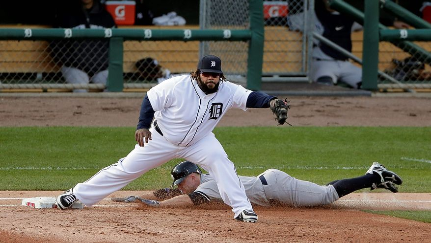 Detroit Tigers 1B Prince Fielder takes the throw from Omar Infante to get New York Yankees' Brett Gardner out at first base during Game 4 of the American League Championship Series on Oct. 18, 2012, in Detroit. (Associated Press)