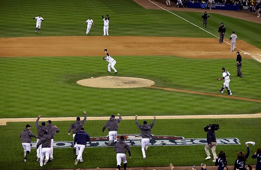 The Detroit Tigers run onto the field after winning Game 4 of the American League Championship Series, 8-1, against the New York Yankees, on Oct. 18, 2012, in Detroit. The Tigers move on to the World Series. (Associated Press)