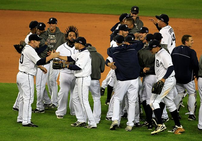 The Detroit Tigers celebrate after winning Game 4 of the American League championship series, 8-1, against the New York Yankees on Oct. 18, 2012, in Detroit. The Tigers move on to t