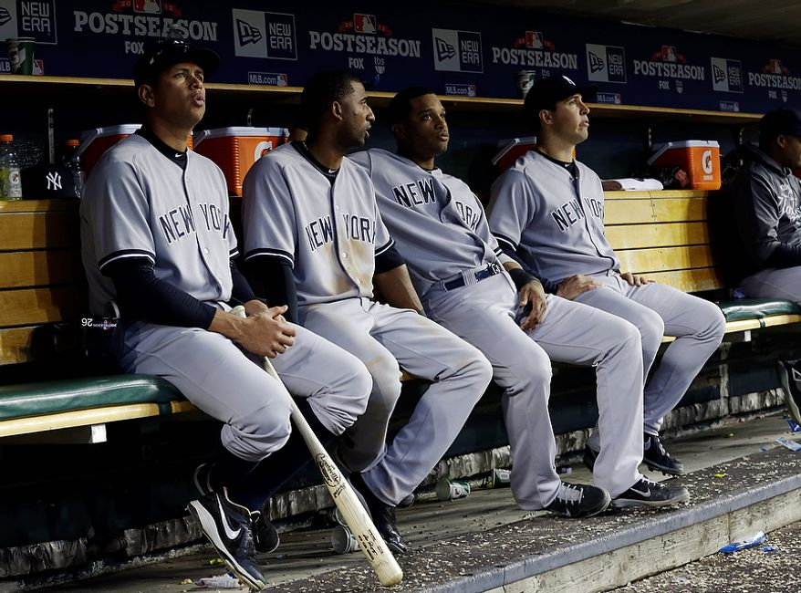 New York Yankees' Alex Rodriguez (left) and teammates sit on the bench in the seventh inning of Game 4 of the American League Championship Series on Oct. 18, 2012, in Detroit. The Detroit Tigers won, 8-1, to advance to the World Series. (Associated Press)