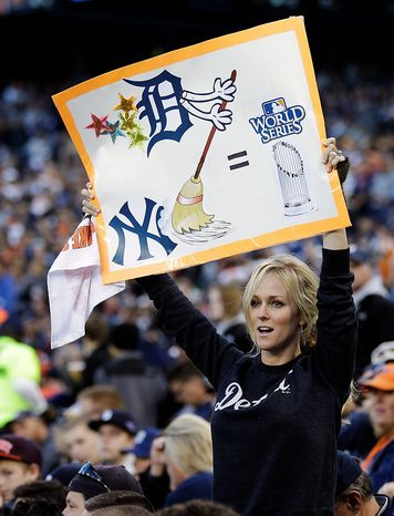 A Detroit Tigers fans holds up a sign in the fifth inning during Game 4 of the American League Championship Series against the New York Yankees on Oct. 18, 2012, in Detroit. (Associated Press)