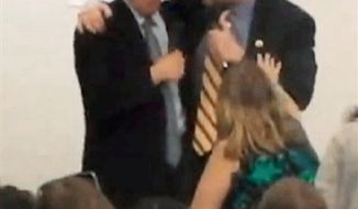"** FILE ** This image from Thursday evening, Oct. 11, 2012, video provided by a Howard Berman campaign videographer shows Brad Sherman, right, putting his right arm around Berman during a debate at Pierce College in Los Angeles. Sherman seized the shoulder of Berman, brought him toward his chest and shouted, ""You want to get into this?"" The physical confrontation between the two veteran Democratic House members vying for the same Los Angeles-area congressional seat is the latest example of a campaign that has become increasingly bitter and personal. (AP Photo/Brandon Hall)"
