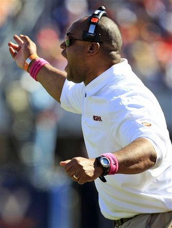 Virginia coach Mike London yells at an official during the first half of an NCAA college football game against Wake Forest at Scott Stadium in Charlottesville, Va., Saturday, Oct. 20, 2012. (AP Photo/Steve Helber)